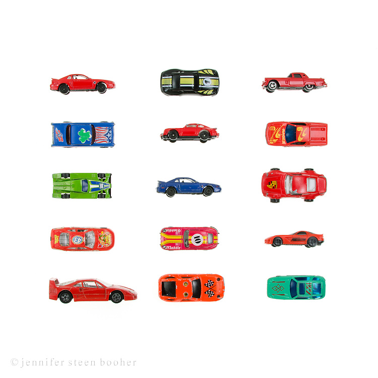 Toy racecars arranged in a grid on a white background.