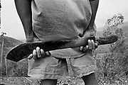 The machete being the weapon of choice, Independence supporters prepare for an expected pro-Jakarta Milita Attack near Hera. Dili East Timor September 1999.