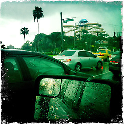 Raining on International Drive at Wet 'n Wild. Orlando holiday 2012. Photo taken with the Hipstamatic photo application on Apple iPhone 4.