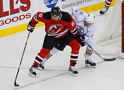 Nov 9, 2008; Newark, NJ, USA; New Jersey Devils center Dainius Zubrus (8) skates with the puck by Edmonton Oilers center Shawn Horcoff (10) during the third period at the Prudential Center. The Oilers defeated the Devils 2-1.
