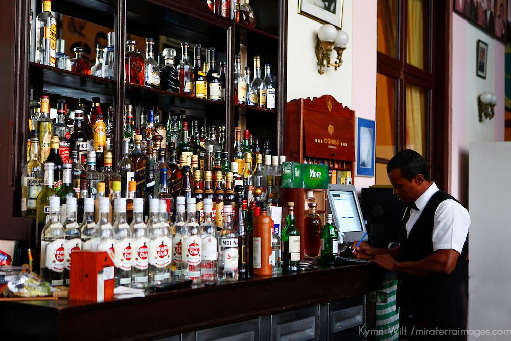 Central America, Cuba, Havana. Bartender in Hall of Fame Bar at Hotel Nacional de Cuba, an iconic landmark in Havana.