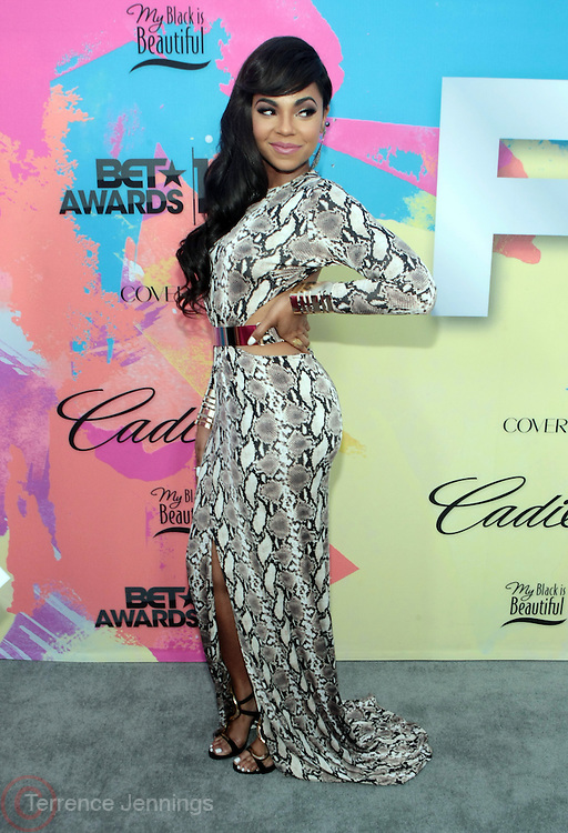 """Los Angeles, CA-June 29:  Recording Artist/Actress Ashanti Shequoiya Douglas attends the Seventh Annual """" Pre """" Dinner celebrating BET Awards hosted by BET Network/CEO Debra L. Lee held at Miulk Studios on June 29, 2013 in Los Angeles, CA. © Terrence Jennings"""