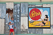 man walking by a painted advertisement in South Carolina