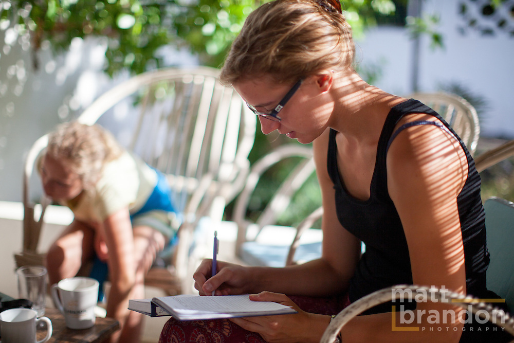 Ameline Peterschmitt, a volunteer writes each bird's data like; wing length, weight and age in a note book for future study.