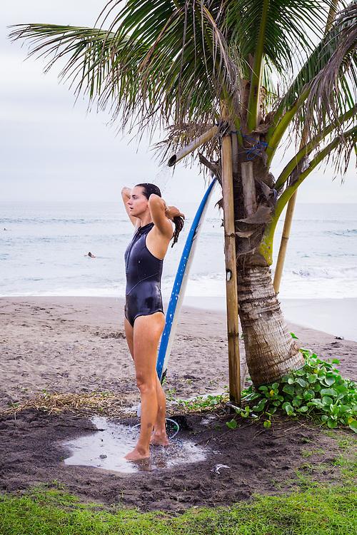A woman is seen showering at Batubolong beach in Canggu.