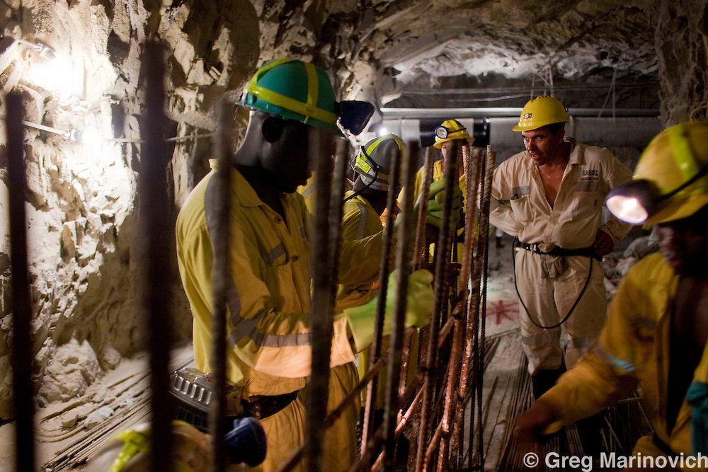 Mponeng mine General Manager Randel Rademann talks to a team working on a recovery room near to where AngloGoldAshanti broke the record and reached deeper into the earth than any other mine previously, with the Mponeng gold mine descending to 3778 meters below the surface Feb 3, 2009. Photo Greg Marinovich