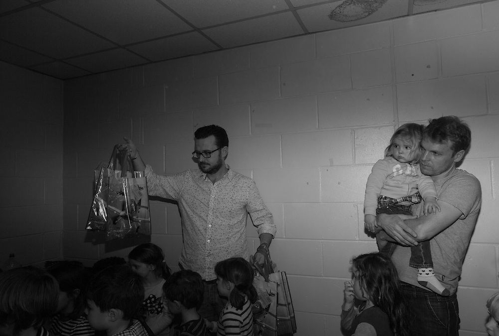 Father's distribute party bags to children who attended Benji's birthday party in Hemel Hempstead,  England Sunday, March 22, 2015 (Elizabeth Dalziel) #thesecretlifeofmothers #bringinguptheboys #dailylife