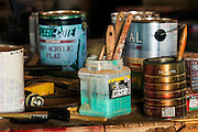 WY02282-00...WYOMING - Paint brushes in workshop at the Willow Creek Ranch.