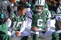 Dec 23, 2012; East Rutherford, NJ, USA; New York Jets quarterback Tim Tebow (15) and New York Jets quarterback Mark Sanchez (6) talk during the first half at MetLIfe Stadium.