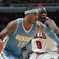 08 November 2010: Denver Nuggets' small forward #15 Carmelo Anthony drives past Chicago Bulls' small forward #9 Luol Deng during the Chicago Bulls 94-92 victory over the Denver Nuggets at the United Center, in Chicago, Illinois, USA.
