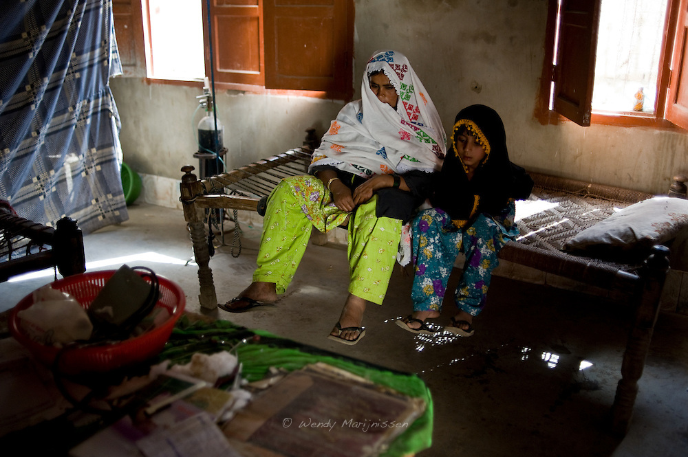 A pregnant woman and her daughter visit the local dai for a check up. Conditions in the rural areas are usually very poor. Most rural delivery places lack hygiene and women have no access to proper and affordable medical care. Kandiaro, Pakistan 2010