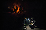 Trapped in Belgrade, migrants take shelter in warehouses. They sleep, cook and eat directly on the warehouse floor.
