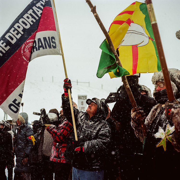OCETI SAKOWIN CAMP, CANNON BALL, NORTH DAKOTA - DECEMBER 5, 2016: Native Americans and up to 700 veterans march in protest of the Dakota Access Pipeline on December 5th, 2016 at the Oceti Sakowin Camp in Cannon Ball, North Dakota.