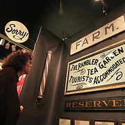 11/08/12 - Wilmington, DE - Antiques Show - Jennifer Mass reviews folk art in the Victor Weinblatt booth at the 49th Annual Delaware Antiques Show Thursday, Nov. 08, 2012, at the Chase Center on the Riverfront in Wilmington DE.   ..SAQUAN STIMPSON/Special to The News Journal