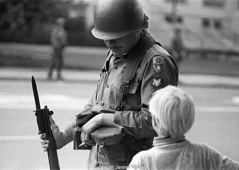 Young child with National guard soldiers  during  People's Park  Student protest & riots in Berkeley California 1969