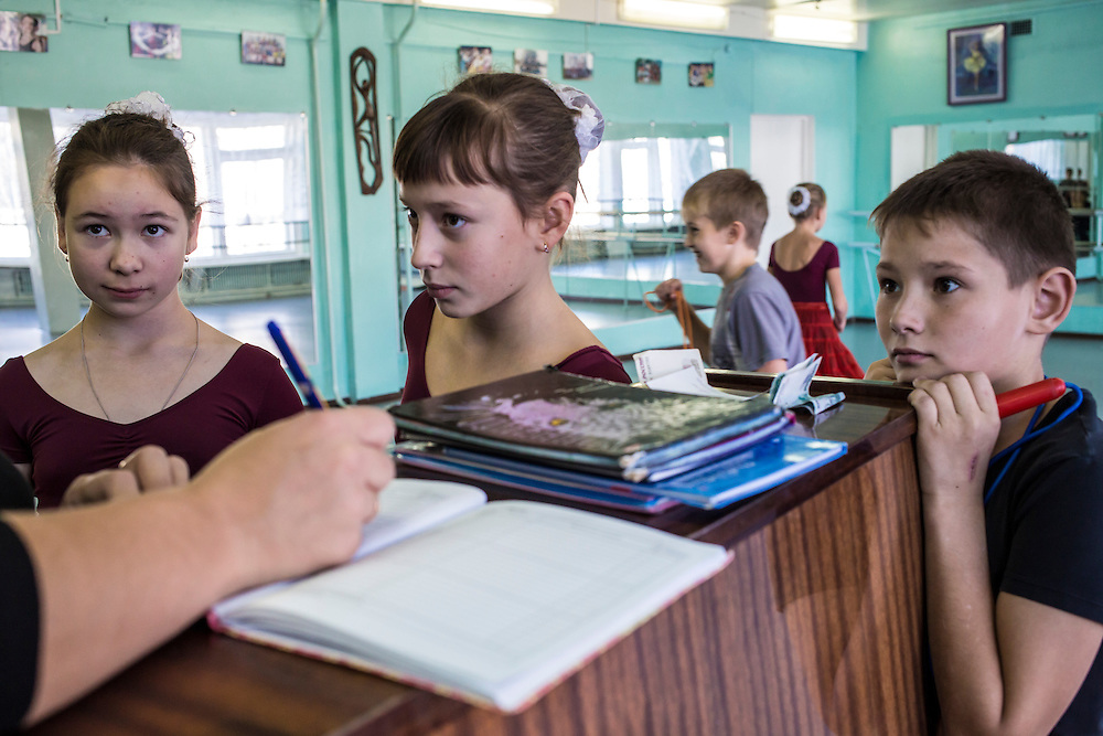 Ballet students talk with their instructor at a school for the arts on Tuesday, October 22, 2013 in Baikalsk, Russia.