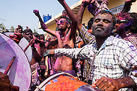 Indian man seen playing music in tradional drums in the eve of Holi festival in streets of Hampi, Karnataka, India, on  March 5, 2015. Holi, also known as the Festival of Colors, heralds the beginning of spring and is celebrated all over India.<br />