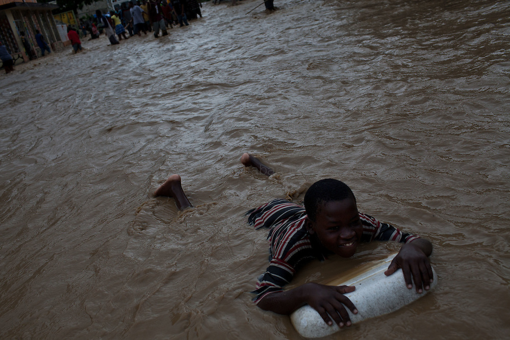 After hurricane Tomas went through Haiti, the city of Leogane has been totally flooded by the heavy rain and the overflow of the river Roullorne.///A young Haitian plays in the muddy water, in a street of Leogane during hurricane Tomas.