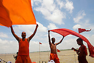 Pilgrims drying clothes in the wind at Tulsi Ghat  by the Ganges river in Varanasi, India.