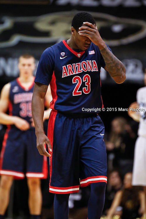 SHOT 2/26/15 9:12:49 PM - Arizona's Rondae Hollis-Jefferson #23 walks off the court after taking an elbow against Colorado during their regular season Pac-12 basketball game at the Coors Events Center in Boulder, Co. Arizona won the game 82-54.<br /> (Photo by Marc Piscotty / &copy; 2015)