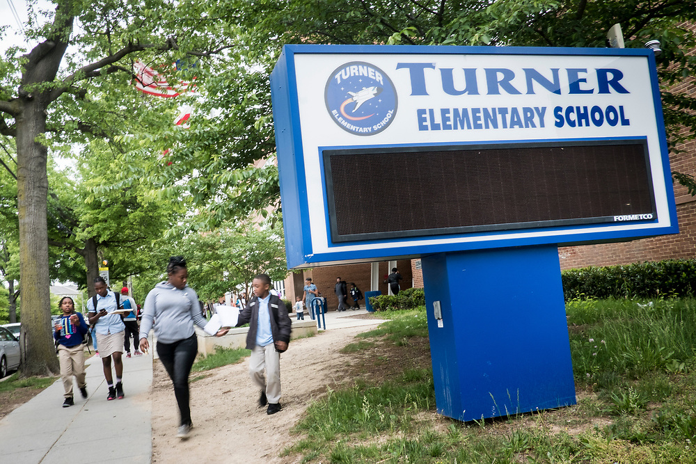 Turner Elementary School students leave school at the end of the day in Washington, D.C., on Wednesday, May 4, 2017.