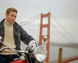 good looking man on a motorcycle by the Golden Gate Bridge in San Francisco, CA