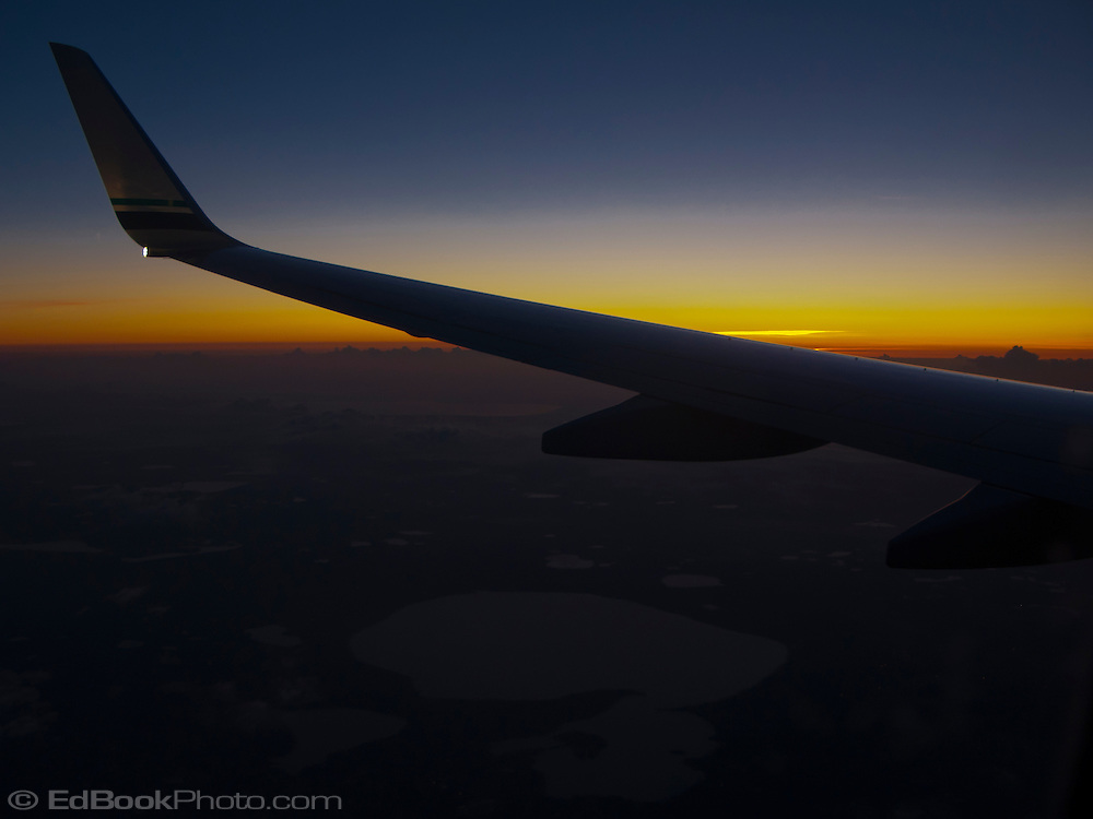 wing silhouette predawn sky on a redeye flight   EdBookPhoto