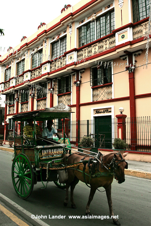 "Calesa or horse and carriage roams the streets of Intramuros.  Intramuros Manila was built by the Spaniards in the 16th century - its name means literally ""within the walls"" which also describes its structure as it is surrounded by thick walls and moats. During the Spanish colonial period Intramuros was considered to be Manila itself."