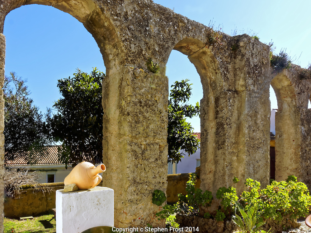 An old garden in Óbidos, Portugal, a walled city, which includes part of the historic Roman aqueduct, that used to supply water to the city.