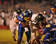 Oxford High's Xavier Pegues (44) makes a sack vs. Lake Cormorant in Oxford, Miss. on Friday, October 5, 2012. Oxford High won 26-0.