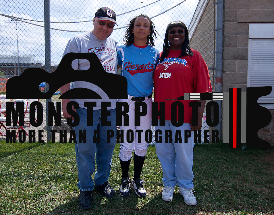 04/21/12 Dover Del. Delaware State Jordan Reid #12 poses with her parents prior to a NCAA Softball game against Norfolk State Saturday, April. 21, 2012 at The Hornets Nest in Dover Del.<br /> <br /> Delaware State defeated Norfolk State 10-0 Saturday afternoon.<br /> <br /> Special to The News Journal/SAQUAN STIMPSON