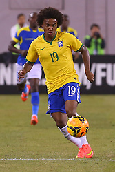Sep 9, 2014; East Rutherford, NJ, USA; Brazil midfielder Willian (19) runs with the ball during the first half at MetLife Stadium.