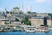"Architect Sinan, who wanted to exceed the grandeur of Hagia Sofia Cathedral, built Süleymaniye Imperial Mosque on Golden Horn harbor from 1550-1557. Süleyman and his wife are buried here. In the West, he is known as Suleiman the Magnificent. In the Islamic world, he is known as the Lawgiver (in Turkish ""Kanuni""; making his formal Turkish name of Kanuni Sultan Süleyman), because he completely reconstructed the Ottoman legal system. This image is from İstanbul, in the Republic of Turkey."