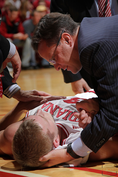 08 December 2012: Indiana head coach Tom Crean comfornts an injured Indiana forward Austin Etherington (13) as the Indiana Hoosiers played the Central Connecticut State Blue Devils in Bloomington, Ind.