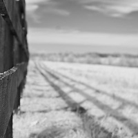 Three plank fence in rural Kentucky.  Infrared (IR) photograph by fine art photographer Michael Kloth.