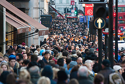 London, December 6th 2014. Tens of thousands throng the streets of London as shoppers take advantages of ongoing deals and discounts offered by retailers in the run-up to Christmas. PICTURED: Thousands of shoppers crowd the pavements of Regent Street.