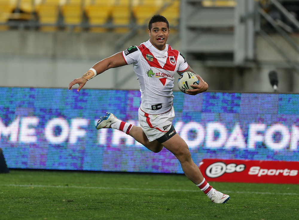 Peter Mata`utia of the Dragons on his way to score a try against the Warriors during their round 22 NRL match at Westpac  Stadium, Wellington on  Saturday, August 08, 2015. Credit: SNPA / David Rowland