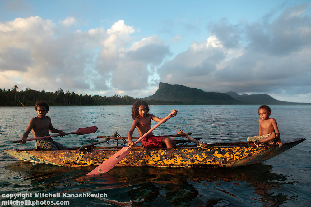 Ni Vanuatu boys paddling a canoe through the lagoon between Rah and Mota Lava Islands, Torba Province, Vanuatu