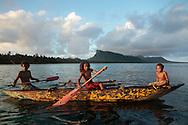 Ni Vanuatu boys paddling a canoe through the lagoon between Rah and Mota Lava Islands, Torba Province, Vanuatu