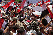 Tens of thousands of Egyptians, including two boys dressed as soldiers, take part in a large July 8, 2011 protest in Tahrir Square in downtown Cairo, Egypt. Many of the protesters have vowed to stay in the square until the demands of the revolution are met, including an end to military trials of civilians, prosecution of police officers accused of murder or torture and open trials of former regime officials including ex-President Hosni Mubarak. (Photo by Scott Nelson/Der Spiegel)