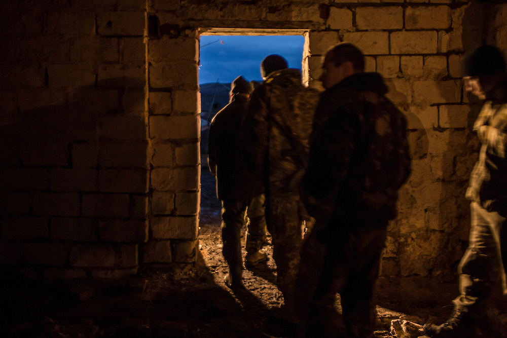 Ukrainian soldiers after the evening roll call and prayer at an artillery depot on Monday, December 14, 2015 near Slovyansk, Ukraine.