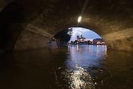 Paris . Flooding . The Seine river under the quay de la Tournelle , in the distance Notre dame cathedral
