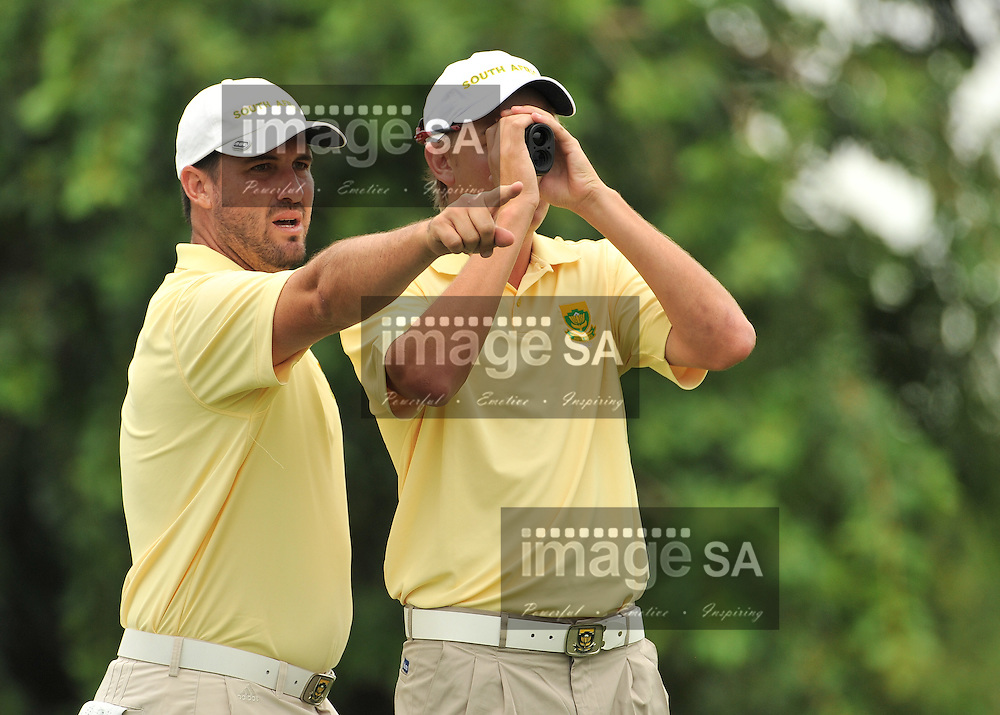 MALELANE, SOUTH AFRICA - Wednesday 18 February 2015, Gerlou Roux of South Africa shows fellow team mate, Stefan Cronje (with rangefinder) the way on the 5th during the first round foursomes of the annual Leopard Trophy, a two day test between teams of the South African Golf Association and the Scottish Golf Union, at the Leopard Creek Golf Estate.<br /> Photo Roger Sedres/ Image SA