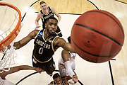 INDIANAPOLIS, IN - MARCH 17: Rashard Kelly (0) of  Wichita State goes to the backboard while playing The University of Dayton takes during the 2017 NCAA Men's Basketball Tournament held at Bankers Life Fieldhouse on March 17, 2017 in Indianapolis, Indiana.