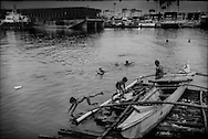 The slum sections in Manila's Port Area are just a meter or two above sea level, and extremely vulnerable to climate change-induce sea rise, flash flood and storm surges from ever-stronger typhoons.  Baseco slum, Port Area, Manila, Philippines. <br /> <br /> On Maplecroft's Climate Change Vulnerability Index, Manila ranks as the world's second most vulnerable city to climate change.  Manila's Tondo and Port Area are Manila's districts most vulnerable to climate change-induced sea rises, storm surges from increasingly strong typhoons and earthquake trigger tsunami.  It has a population density of nearly 78,000 people per square km (202,800 ppl/sq mi), according to a 2009 Cornell University report.  (Note: Manhattan has a population density of 26,939/km2 [69,771/sq mi].)