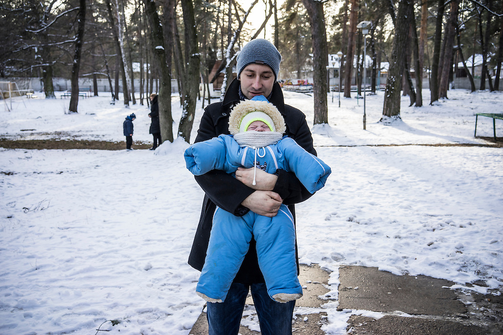 Denis Golba, 26, with his daughter Nikita, age two months, at the Perlyna Donetchyny children's resort, where they are temporarily seeking refuge after fleeing fighting between pro-Russia rebels and Ukrainian forces in the heavily-contested town of Debaltseve on Monday, February 9, 2015 in Svyatogorsk, Ukraine.