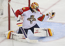 April 24, 2012; Newark, NJ, USA; Florida Panthers goalie Scott Clemmensen (30) makes a glove save during the second period of game six of the 2012 Eastern Conference quarterfinals at the Prudential Center.