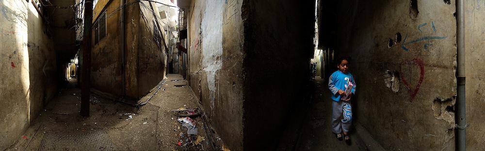 A little girl walks through a Palestinian refugee camp, Lebanon