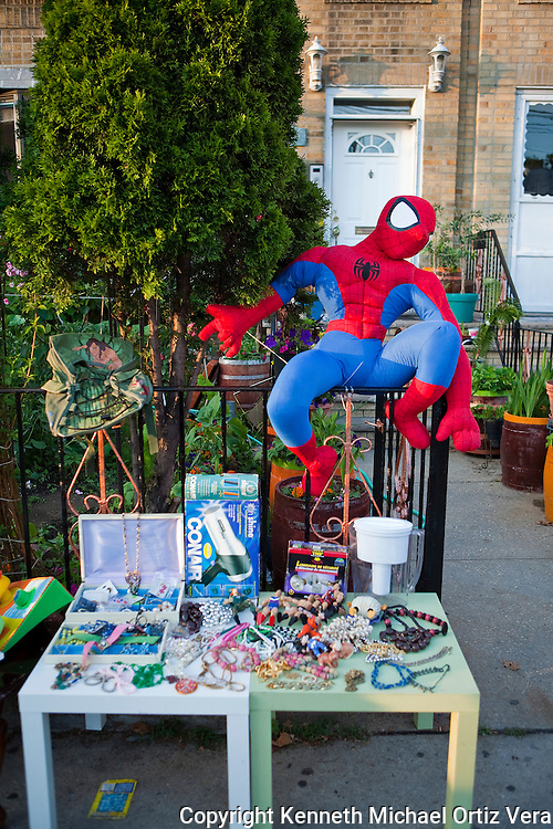 A local yard sale on Ditmars Boulevard shows some of the things people regrettably but and the hope to get rid of.