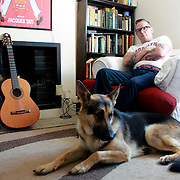 Portrait of actor/director Tony Pitts at home with his dog Mischa.